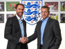 Former defender signs four-year deal to lead Three Lions