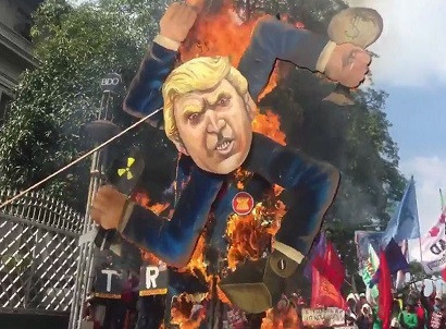 16 hurt in clashes as Manila protesters burn Trump swastika effigy