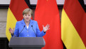 Merkel in China, says Berlin, Beijing support Iran nuclear deal
