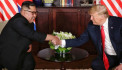 Here's the moment President Donald Trump met Kim Jong Un for the first time