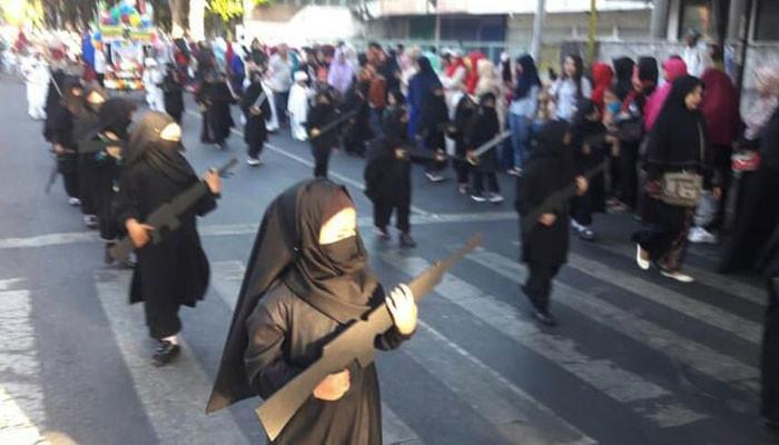 Kindergarten dresses children as jihadis for parade in Indonesia