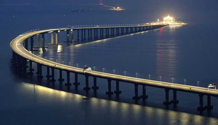 World's longest sea-crossing bridge which stretches 34 MILES and cost £14billion to build will open this week in China