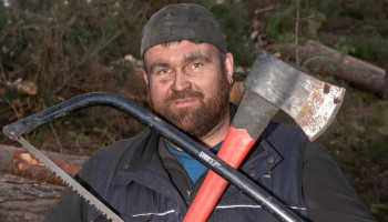LUMBERJACKPOT Lotto lout Michael Carroll cuts logs and delivers coal for £10 an hour after blowing £10m jackpot