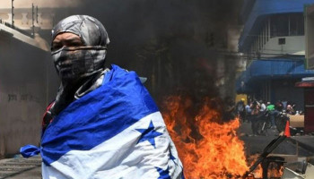 Honduras protests: Buildings burn during clashes over reforms