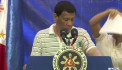 Cockroach crawls up Philippines' Duterte during live speech