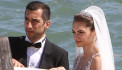 Arsenal midfielder Henrikh Mkhitaryan kisses his beautiful bride Betty Vardanyan as they marry in Venice