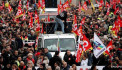 French workers take to streets to protest over pension reform