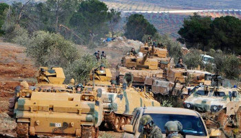 Turkish military convoy crosses Syria border, heads to southern Idlib