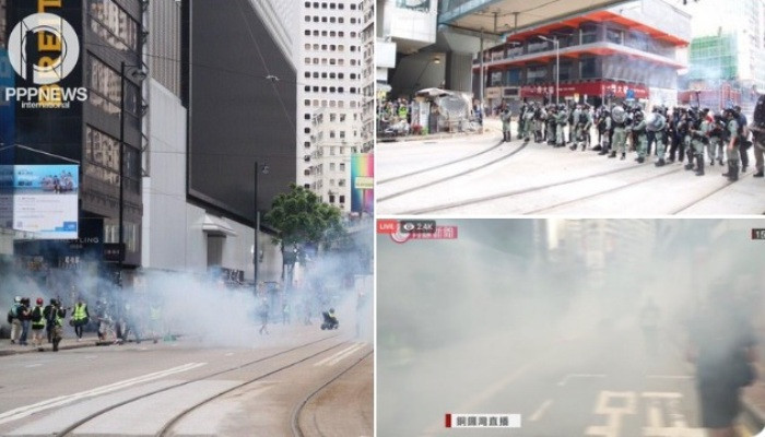 Hong Kong: Tear gas fired as thousands protest new security law