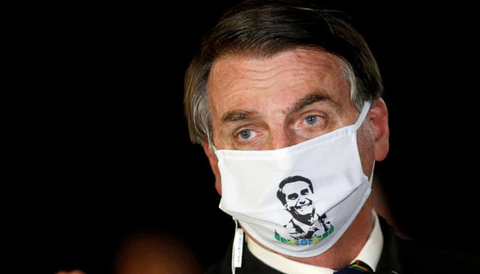 Bolsonaro tells journalist he would 'like to smash your face in' over corruption claims